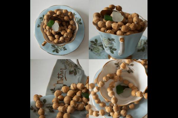 Tea Cup Sculpture Taking Care