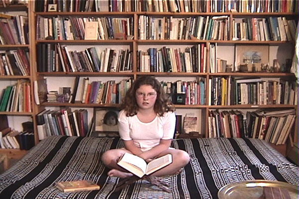 Baalqis with book, from video by Jamelie Hassan